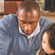 african american male math teacher and young female math student | Classroom Discussions in Math