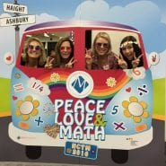 math solutions marketing team in photo booth with psychedelic bus, haight and ashbury street signs, a math solutions 'M' icon | peace, love & math
