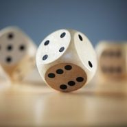 wooden dice rolling on a table