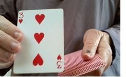 hands holding a deck of cards and showing the 3 of hearts card | Marilyn's Blog: The 1–10 Card Investigation