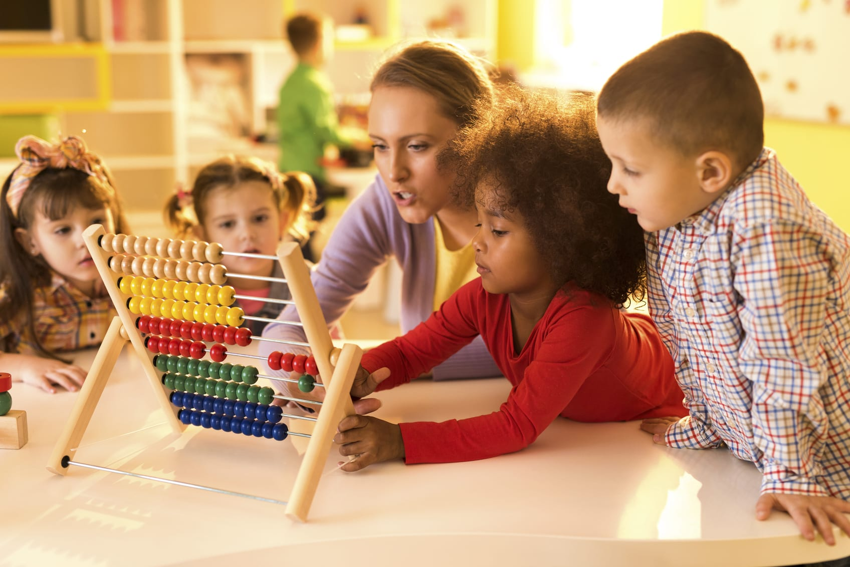 Diverse group of young children and teacher counting with abacus at preschool. | Math Solutions, Classroom Lessons, Counting Crocodiles