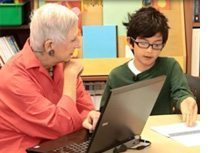 Marilyn Burn's, founder of Math Solutions, sitting with a young student. listening to his reasoning