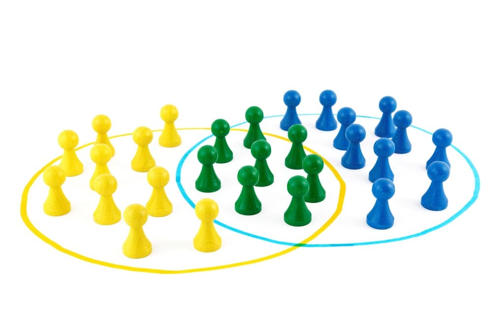 colorful teams of board game pieces intersecting in a Venn Diagram