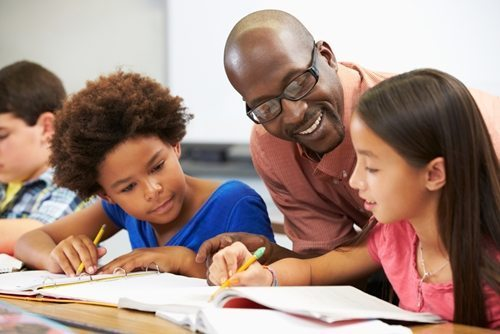 young math students with male teacher | Scaffold learning provides a framework for achievement.